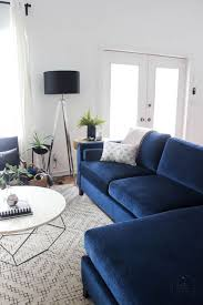 Interior Decorated Living Rooms Adorable The Tiled Fireplace And Blue Couch Are Stunning Comfy Home Decor