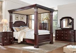 Unique canopy bed Wrought Iron Rooms To Go Dumont Cherry Pc Queen Canopy Bedroom Bedroom Sets Dark Wood