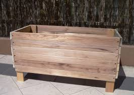 large old reusable and reclaimed raised wood planter boxes with legs for front yard or side yard garden house design ideas