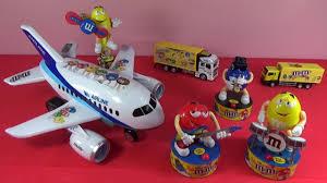 unboxing m m s plane toy dreamliner m m s mercedes man truck m m s rock stars players surprise gifts