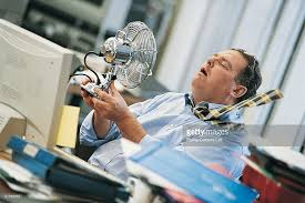 hot office pic. Businessman In A Hot Office Holding An Electric Fan To Himself : Stock Photo Pic