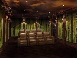 acoustic wall panels featuring abstract mural forest themed home theater design