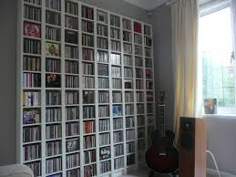 huge and tall cd storage solution ideas with guitar and amplifier a part huvivlc