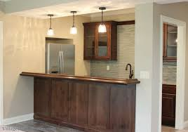 wet bar lighting. Wet Bar Cabinets In A Lower Level Of Bettendorf, IA Home. | VillageHomeStores Lighting