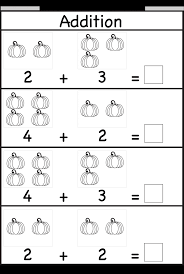Kindergarten Kids Practice Adding Single Digit Numbers And Writing ...