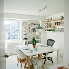 exle of a danish freestanding desk painted wood floor craft room design in london with white