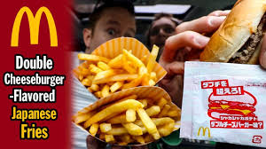 mcdonalds double cheeseburger and fries. Contemporary Mcdonalds Eating Double CheeseburgerFlavored Japanese McDonaldu0027s French Fries Intended Mcdonalds Cheeseburger And H