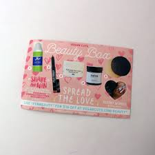 each vegan cuts beauty box es with an information card deling the items for that month