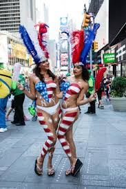Tourists annoyed by painted naked ladies in Times Square NY.