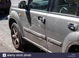 damage to side of car stock image