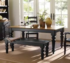 farmhouse look wood stained top with black brown base and chairs