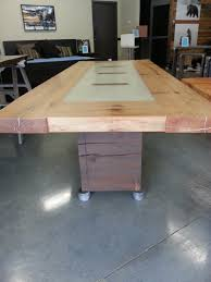 wood slab dining table beautiful:  year old  inch thick reclaimed spruce table with local white aggregate and end grain timber details all coated with a beautiful matte epoxy finish