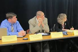 stateimpact na part  state board members brad oliver left troy albert and supt glenda ritz listen