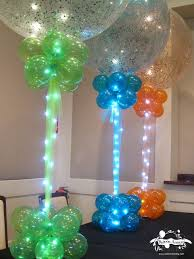 green blue orange sparkle balloons with balloon bases lights