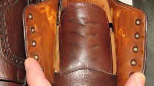 the leather darkening was likely due to the water being absorbed into the leather as the shoes dried out and the leather lighthened up