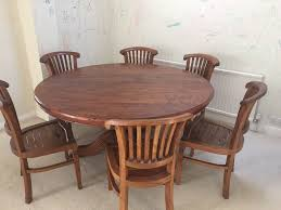 indonesian solid teak wood round dining table and 8 chairs dining table and 8 chairs uk