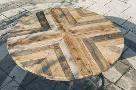 They must be versatile too to bring some out standing features in your living spaces. Round Top Table Made Of Pallets Diy Diy Table Top Wood Patio Table Wood Table Diy