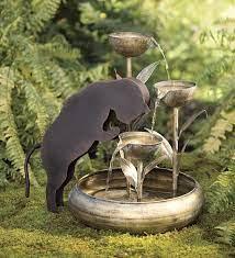 metal cat fountain in indoor fountains