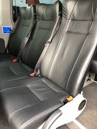row of 3 black leather trimmed seats inside minivan