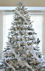 Silver and White decorated Christmas Tree with faux snow|One More Time  Events-www