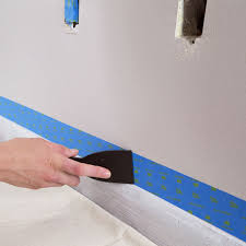 press painter s tape down with a putty knife