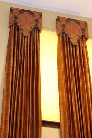 Custom cornices and draperies paired with cellular/honeycomb shades. Budget  Blinds of Benton