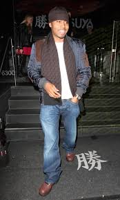 spotted nas in nike acg boots and fendi skull cap scarf