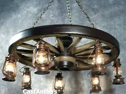 wagon wheel chandelier diy wheel chandelier wagon wheel mason jar chandelier diy