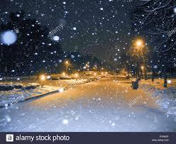 Snowfall Blizzard Lights Winter Park At Night Snowfall And Orange Light Lanterns