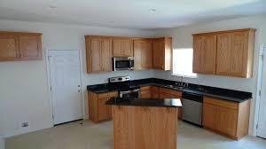 black granite countertops with oak cabinets photo 25