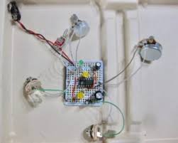 can a cigar box guitar sound be improved dr bob s pace this is based on an lm386 amplifier chip and runs on 9 12 vdc it has a volume and gain control and plays clean or gritty this is the schematic