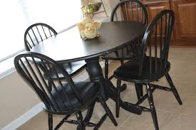 Round kitchen table with leaf Build In Leaf Solid Black Round Kitchen Table With Leaf Including Black Chairs With Black Seat Cushion World Market Kitchen Solid Black Round Kitchen Table With Leaf Including Black