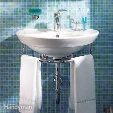 Installing bathroom sink Countertop Installing Bathroom Sink The Family Handyman Installing Bathroom Sink Wallhung Sink Family Handyman The