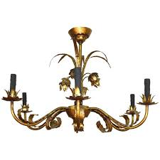 gilt tole chandelier with faux black candles and fl detail