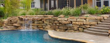 Patio with pool Stained Concrete Tiered Patio Fireplace Pool And Screenedin Porch By Green Guys In St Diy Network Featured Project Tiered Patio Pool And Porch Green Guys