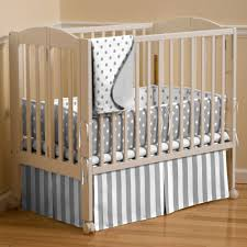 light grey and white polka dot crib sheet