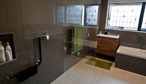 a new bathroom with grey tile wall