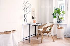 interior of office. Modern Scanidinavian Interior Of Home Office With Glass Table, Design Clock  Paper Bags And Plants