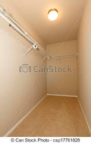 Image Rod Walkin Empty Closet Csp17761828 Can Stock Photo Walkin Empty Closet Empty Walkin Closet With Beige Walls And Ceiling
