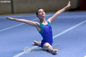 floor gymnastics splits. Exellent Gymnastics Male Boy Gymnast Performing Splits During His Floor Routine In Competition On Gymnastics