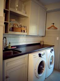 fab minimalist white laundry room decorating designs with cool stainless steel laundry sink and white cabinetry storage in small space ideas