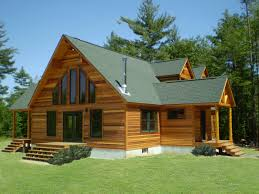 wooden custom designed modular homes with pointed roof and thin black framed windows plus glass two door facing small wooden floorporch and stairs also