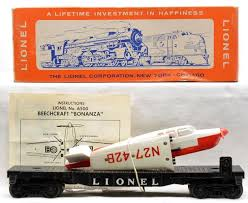 17 best images about lionel trains train room lionel postwar 6500 beechcraft bonanza transport flatcar white over red airplane and instruction sheet in