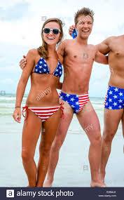 Men swimming in women's bikini