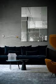 midnight dark blue sofa and grey carpet