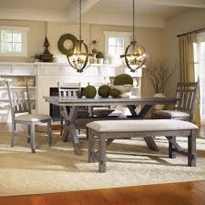 dining room bench seating: long grey modern dining room bench made of fabric seat and wooden base legs
