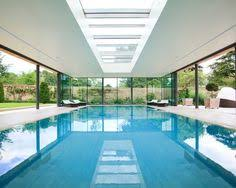 indoor swimming pool design. indoor swimming pool design ideas equipped with white ceiling unit best glass panel plan