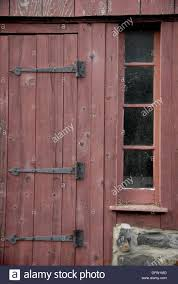 old barn door hinges. The Hinges Still Hold On An Old Barn Door