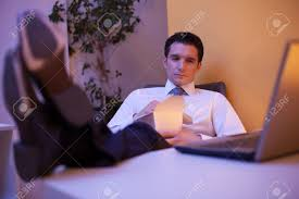 tired businessman trying to stay awake while eating chinese food stock photo tired businessman trying to stay awake while eating chinese food late at night in the office