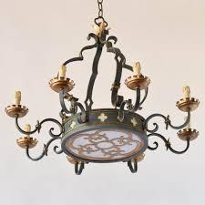 antique iron chandelier with quatrafoil design